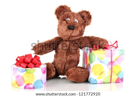 Sitting bear toy with gifts isolated on white