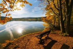 Sitting by a lake in autumn colors