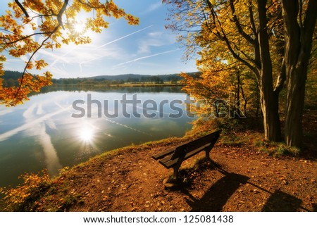 sitting by a lake in autumn...