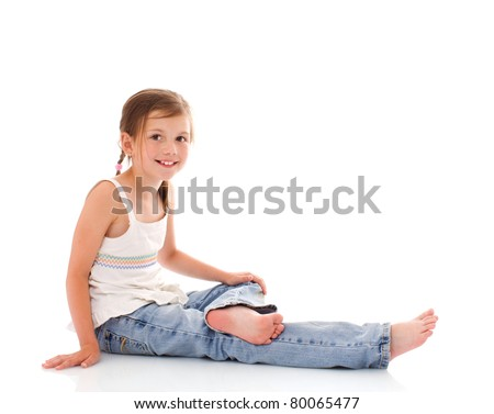 Sitting little girl happy portrait isolated on white