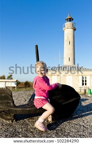 sitting little girl, Richard Lighthouse, Aquitaine, France