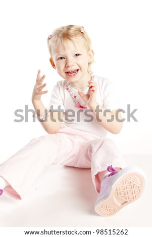 sitting little girl wearing necklace
