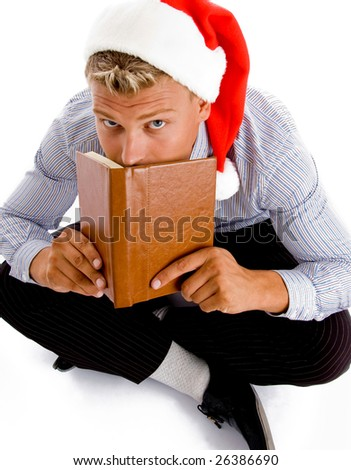 sitting man with book and christmas hat with white background