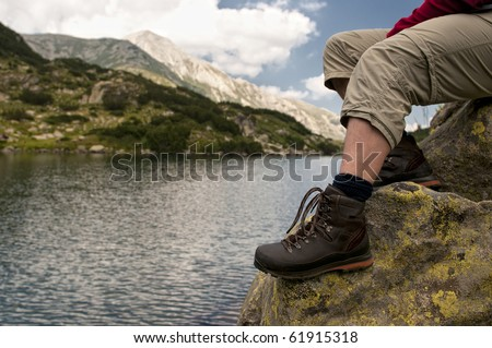 sitting on a mountain lake