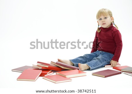 sitting on the floor between  red books  little girl