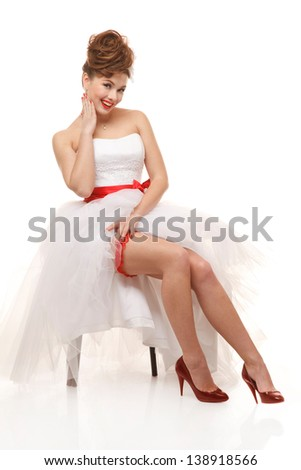 Sitting pin-up bride.Professional make-up, hair and style