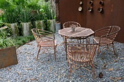 sitting space in the garden design idea for small area decorating by steel wall and tree pot