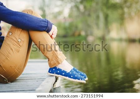 sitting woman's feet in a...