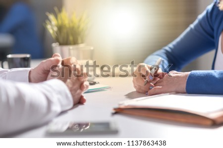 Situation of business negotiation between businesswoman and businessman, light effect #1137863438