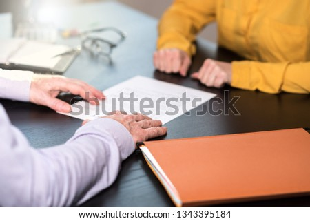 Situation of business negotiation between businesswoman and businessman, light effect #1343395184