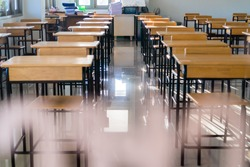 Situation of Covid-19 disease outbreak resulted in inability organize teaching learning in college. Lecture school empty classroom with desks chair iron wood when student close stay home in highschool