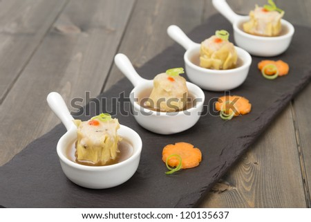 Siu Mai  - Chinese steamed pork dumplings in sauce.