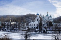 Siversky Donets River winter. On the opposite bank the Cathedral of the Assumption and the Holy Church of the Intercession. Sviatohirsk Lavra, Ukraine