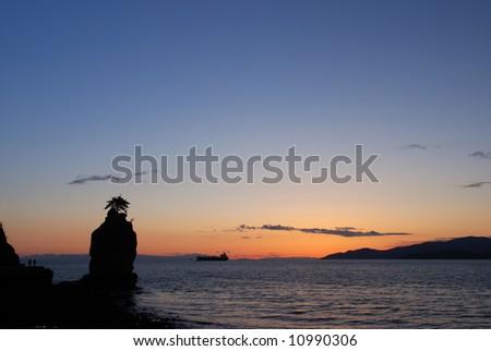 siwash rock at sunset, stanley park, vancouver