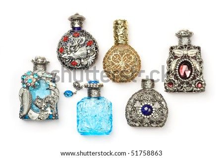 Six antique perfume glass richly ornate bottles, isolated on white.