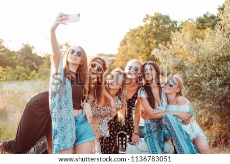 Six beautiful girls make selfie in nature in the countryside #1136783051