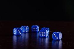 Six blue dice on black background