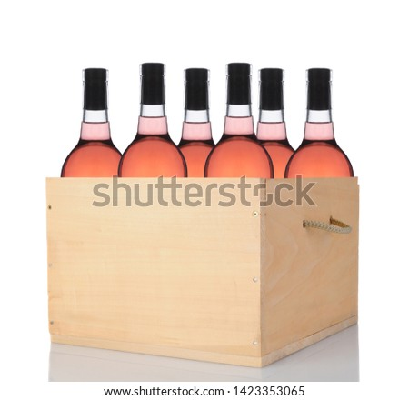 Six Blush Wine Bottles in a wooden crate. Vertical format isolated on white with reflection. #1423353065