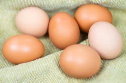 six chicken eggs in linen rag