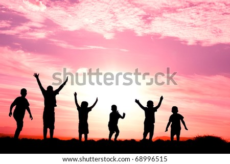 six children jumping for joy silhouetted sunset