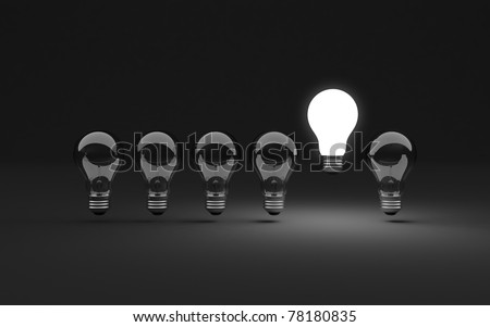 Six clear light bulbs, one illuminated