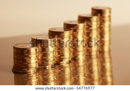 Six coin piles with reflection in gold color