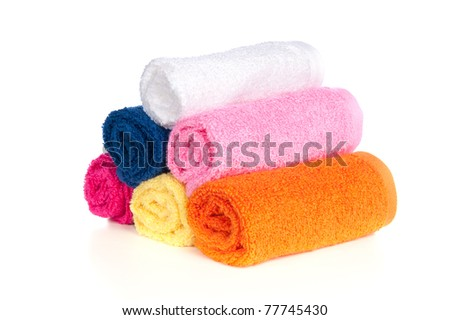Six colorful bath towels on a white background