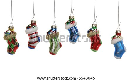Six colorful Christmas stocking ornaments isolated over white