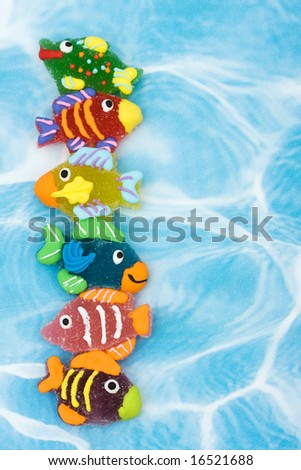 Six colorful fish on blue background making border, gone fishing