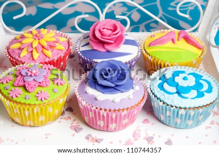 Six colorful party cupcakes for wedding or birthday party