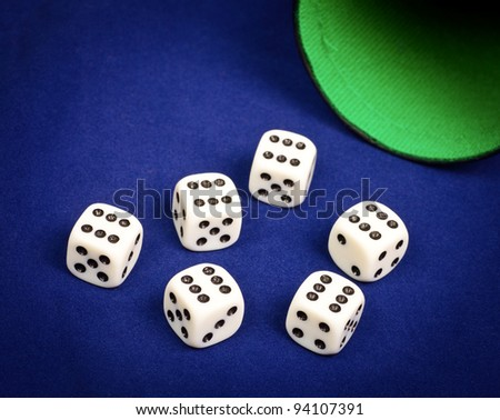 Six dice with number six facing up on blue board