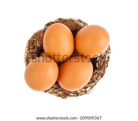 six eggs in a nest on white background
