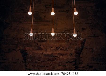 Six electric bulbs that illuminate interior space #704254462