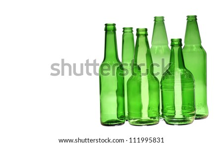 six empty glass green bottles of different size over white background