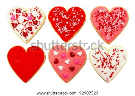 Six individual heart-shaped cookies for Valentines Day over white
