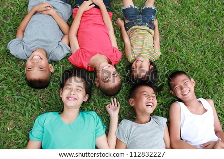 Six kids having good time in the park. - stock photo