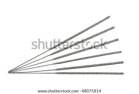 six laying sparklers isolated on white background