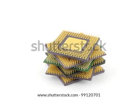 Six microprocessors over white. Shallow DOF.