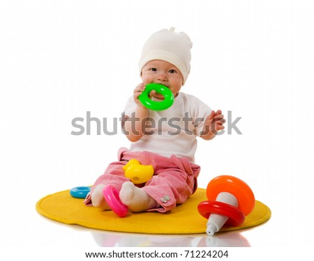 Six month Baby playing with toys isolated on white