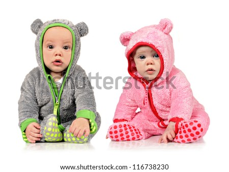 Six month old twin brother and sister on white background