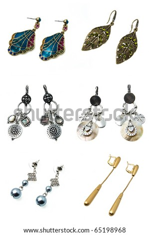 six pairs of bright colourful earrings isolated on white
