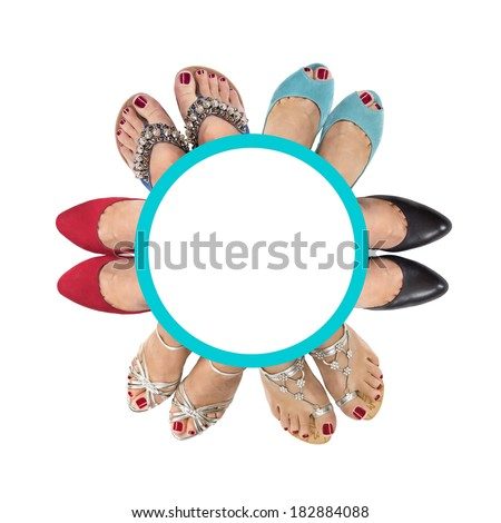 Six pairs of female legs on a white background. View from the top.