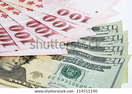 six piece of one hundred dollar of  New Taiwan Dollar cash and five piece of twenty  dollars of US case with white backuground close up