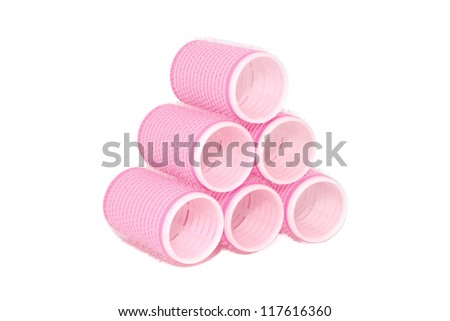 Six pink velcro rollers stacked in a pyramid, isolated on a white background