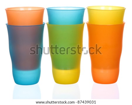 Six plastic multi-colored glasses isolated on a white background. Plastic glass of various color isolated on white background