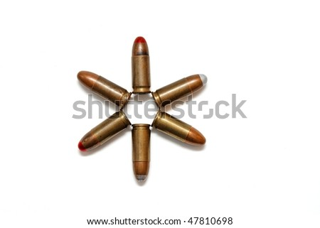 Six-pointed star made of 9mm Parabellum cartridges isolated