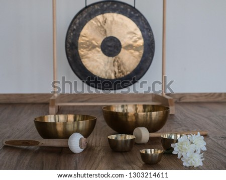 six singing bowls with gong in the background  Сток-фото ©