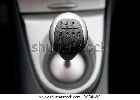 Six speed gear stick in a brand new sport car (shallow DoF) #3654688