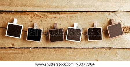 Six Squary  photo frames in a row on wooden background