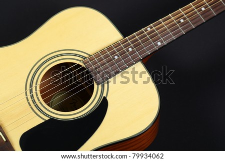 Six-string acoustic guitar - stock photo